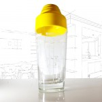 Yellow topped vintage cocktail shaker .